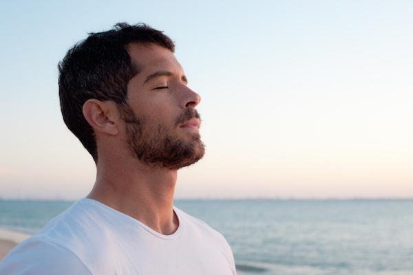 young man relaxed on beach.jpg.jpg