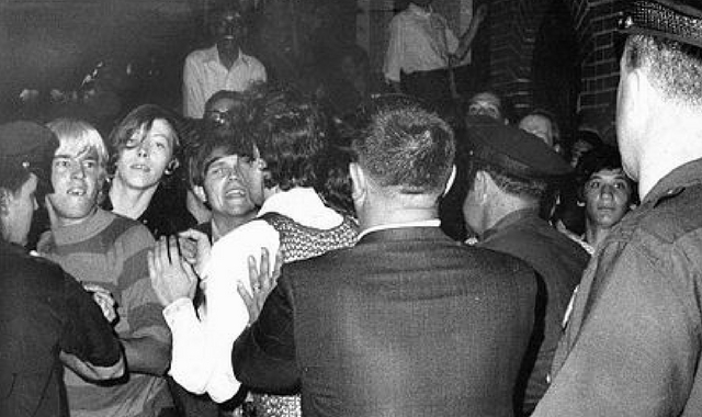 Stonewall riots 1969. Young people fighting with Police.