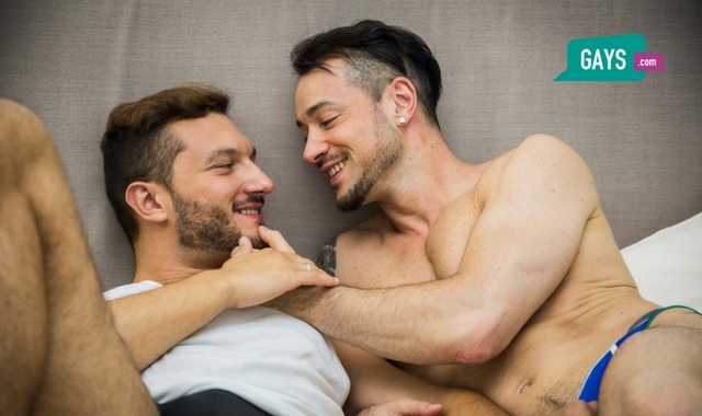 Gay male couple on the bed getting ready for sex