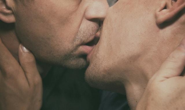 two gay men kissing