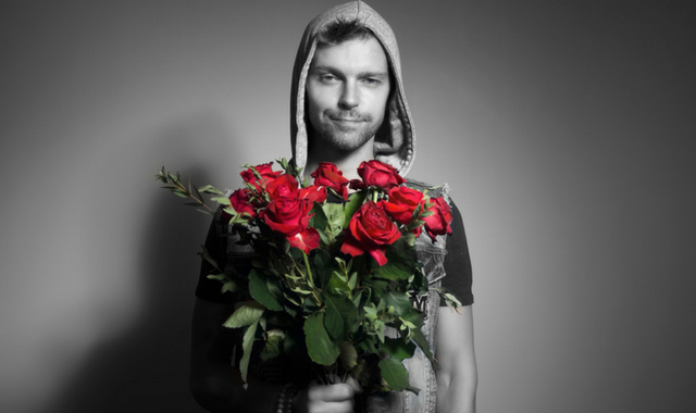 man holding a bunch of roses