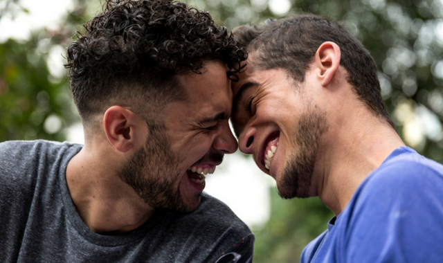 two gay men laughing having fun